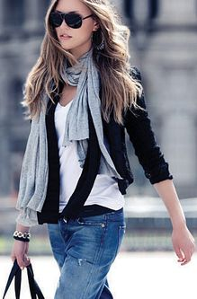 Classic on-the-go look: the scarf, the jeans, the t-shirt and the vest.  Don't forget to accessorize with shades, a tote and nice ankle boots!