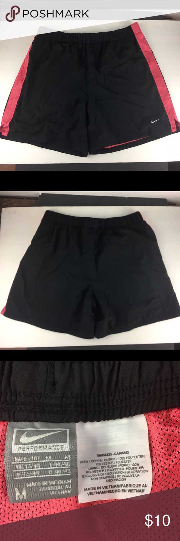 Nike Athletic Black and Pink Shorts Size M Selling one pair of Nike Athletic shorts. The shorts are black with pink mesh stripe and slit on side. Shorts have elastic waist with a drawstring. In good condition. No rips, tears, or stains. Nike Shorts