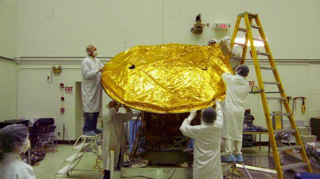 A heat- and radiation shield. The sun transmits heat on Earth mostly by warming the atmosphere, and we experience that heat by convection, like a turkey in the oven. In space direct impact from radiation transfers heat, like a dish warmed in a microwave. As a result, keeping instrumentation cold is less about insulation than about reflection, and gold has some very desirable qualities in this regard. We still need to add insulation for planet exploration.