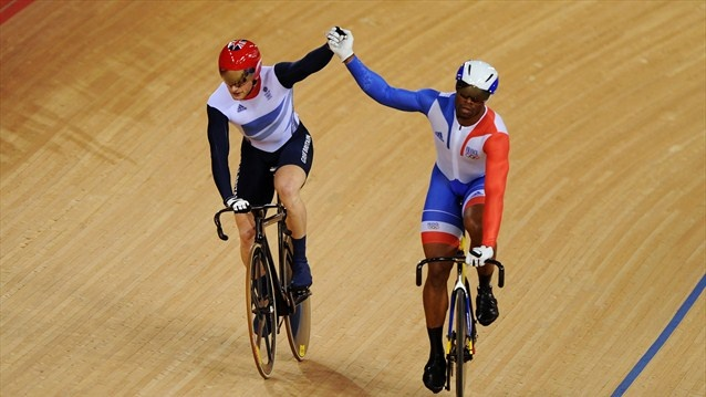 Jason Kenny of Great Britain (L) celebrates winning the second heat against Gregory Bauge of France during the men's Sprint Track Cycling Final to win the gold.