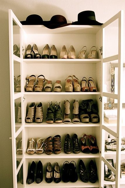 Bookcase with glass doors used as a shoe wardrobe.  This is a good idea for the Ikea BILLY