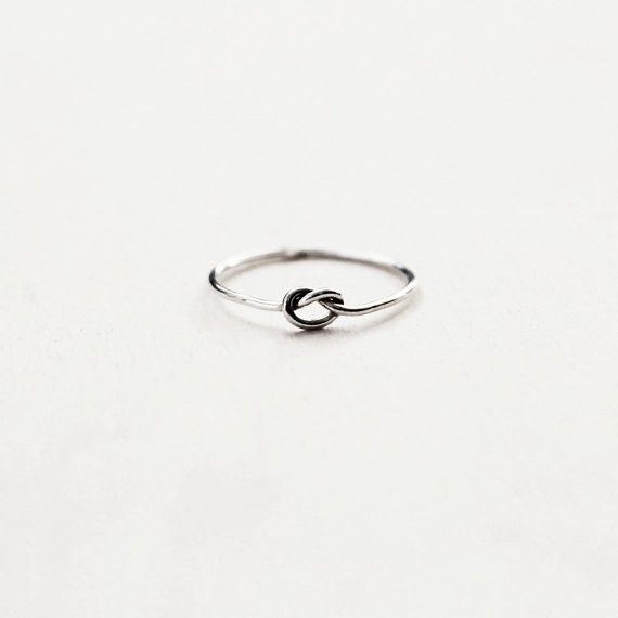 This delicate sterling silver forget me knot ring is simple and dainty, yet makes quite a beautiful little statement ring. They look simply stunning on their own and work great paired with other stack