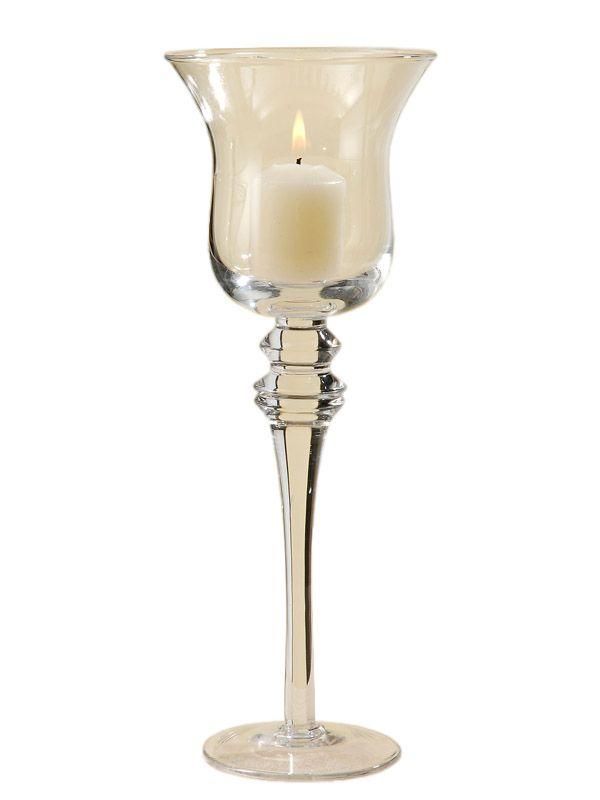 Crează o atmosferă intimă punându-ţi în evidenţă lumânările cu ajutorul paharului cu picior Tina. Paharul este conceput din sticlă, este susţinut de un picior cu talpă iar înălţimea lui este de 30 cm. Vă recomandăm acest produs pentru a crea un aranjament pe orice masă festivă sau pentru al integra în decorarea căminului propriu.