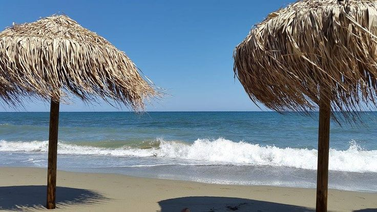 Relax and unwind on a beach bar in the long sandy beach of Magazia on the north-east coast of Skyros island, Greece