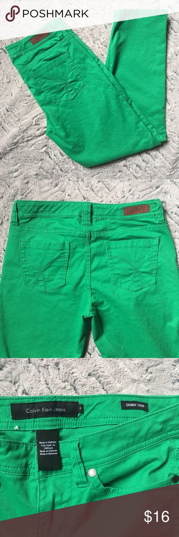 """Calvin Klein Skinny Crop Kelly Green Pants Excellent condition Calvin Klein Skinny Crop Jeans. Bright Kelly green. No flaws! 5 pocket design. Some stretch with 97% cotton, 3% elastane. Measurements I have taken: inseam 25"""", waist laying flat 14"""",  hips 35"""", front rise 8.5"""", leg opening 13"""". Offers welcome on any of my listings. Calvin Klein Jeans Jeans Ankle & Cropped"""