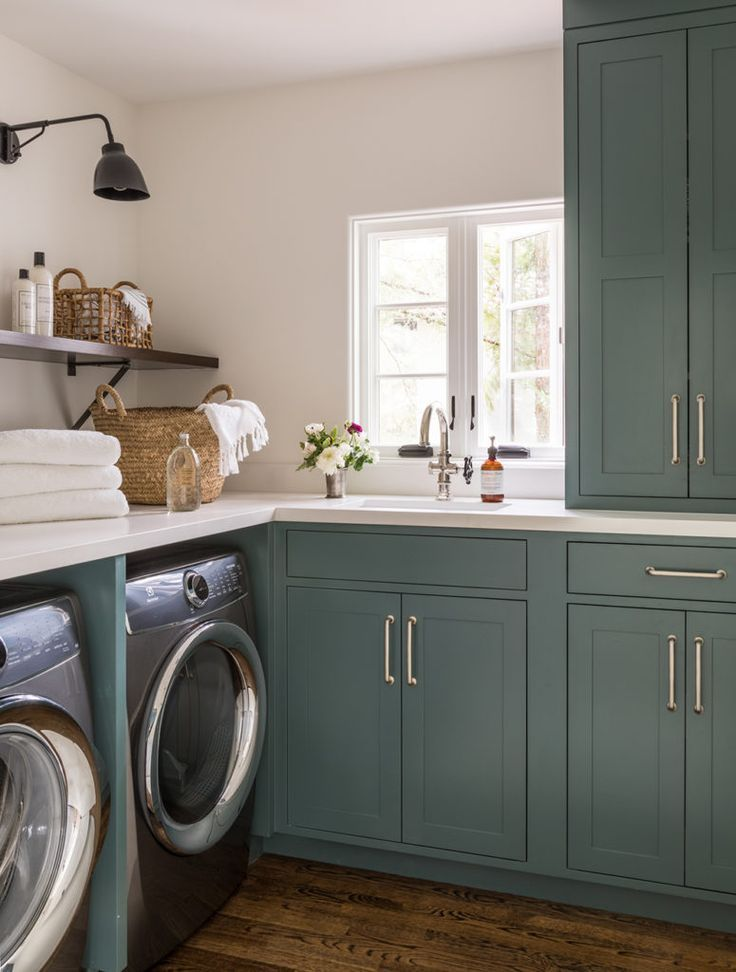 Teal painted cabinets with brass hardware | Jute Home