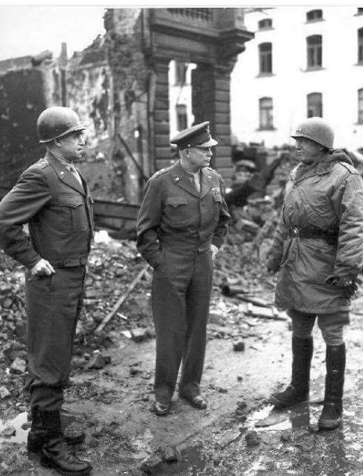 Generals Omar Bradley, Dwight Eisenhower, and George Patton in Bastogne, Belgium in January 1945.