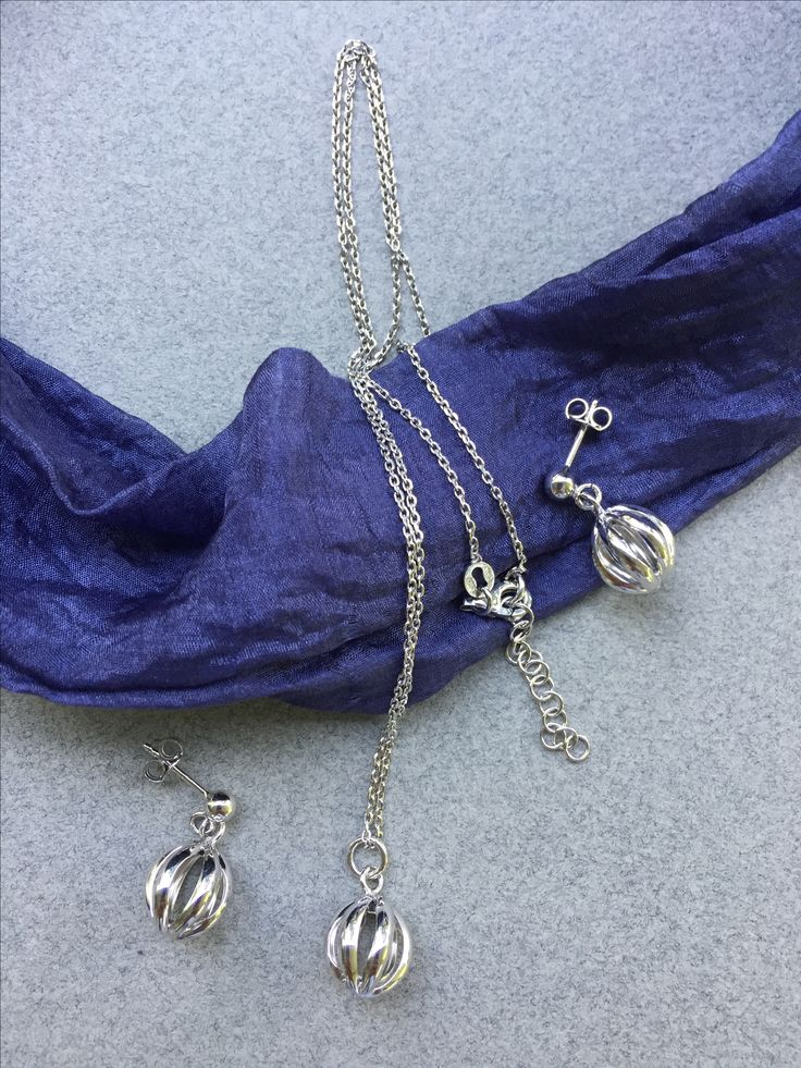 Silver ball formed earrings and necklace set