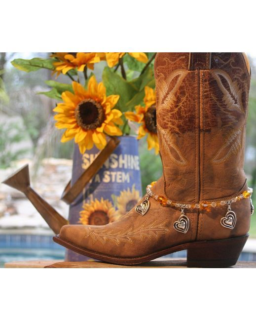 "Boot Candy's Sweetheart of the Rodeo contains beautiful Sunflower Czech Fire Polished Crystals, Oval Detailed Silver Bails, and 4 Silver plated Hearts. Adjustable from 14.25"" to 15.75"" fits your cowboy boots, your fashion boots and your winter boots, too! Made in Texas, USA."