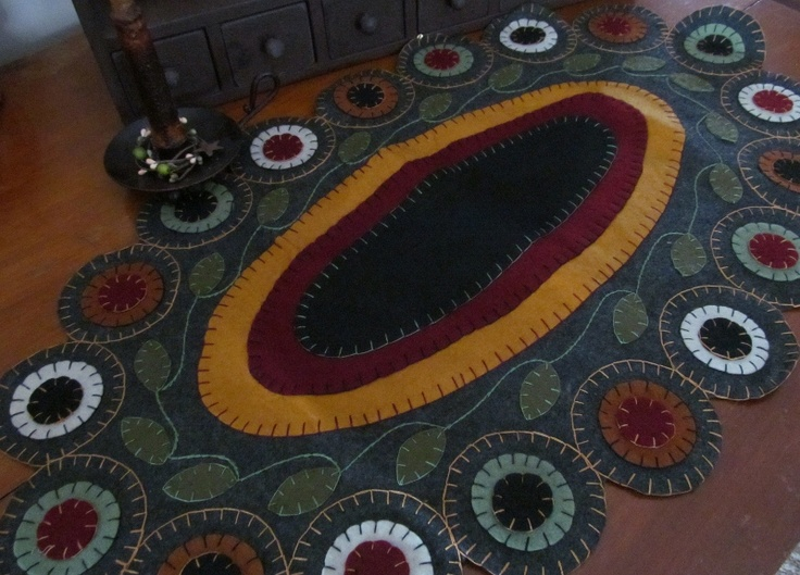 find this pin and more on penny rugs
