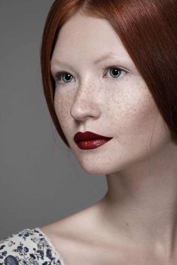 Love this photograph but have pinned it to hair and make-up for the flawless complexion and the dark red lips.  it is by Anastasia Galaktionova