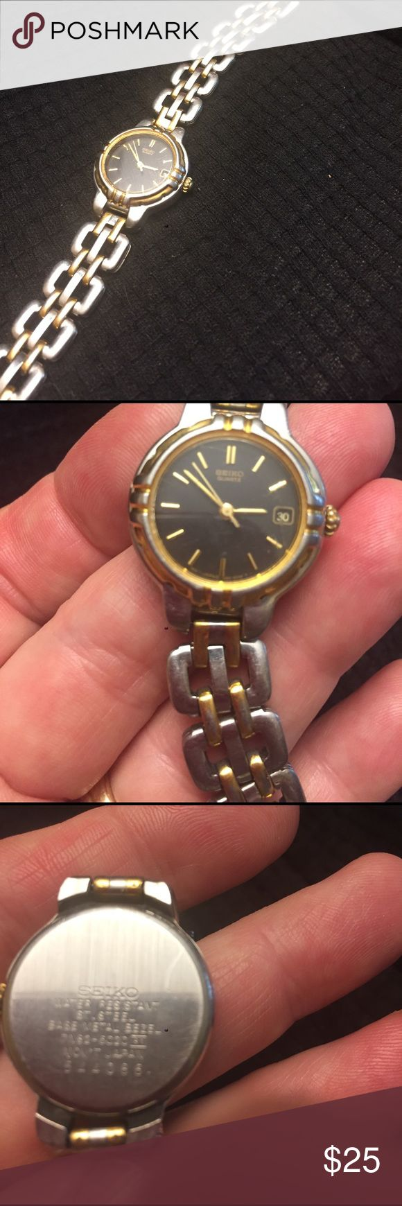 Seiko gold and silver watch Seiko gold and silver ladies watch.  Black face.  Small scuffs on the crystal, not very noticeable .  Will replace battery for buyer. Seiko Accessories Watches