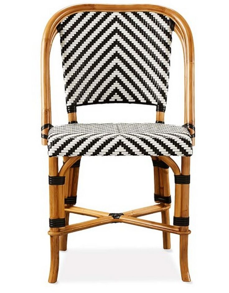 Black, white, and rattan chair More