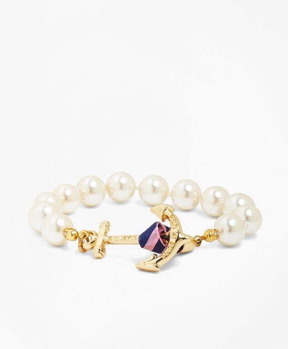 "<a href=""#pdplearnmore"" class=""lm""> Kiel James Patrick </a>for Brooks Brothers<br>Pearl bracelet hand-knotted 10 mm glass pearls with anchor clasp with BB#5 stripe ribbon end. Anchor clasp has Brooks Brothers and KJP logos. Made in the USA.MEASUREMENT<br><br>XS"