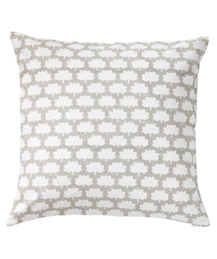 Lotus shaped pattern is block printed to form the complete front of the cushion while the back is block printed with a line pattern. A subtle shade of brown gives the cushion a very earthy look. www.theindianpick.com