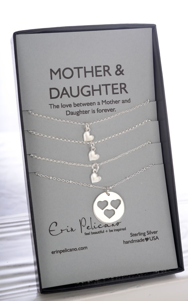 "This handmade Sterling Mother & 3 Daughter Necklace represents bonds of love between a mother & her daughters. Mother-18"" chain. Daughters-16 or 18"" chain."