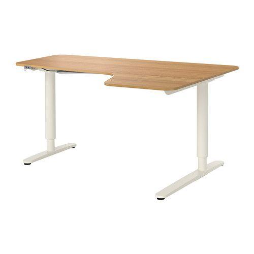 IKEA - BEKANT, Hörnskrivbord höger sitta/stå, ekfaner/vit, , 10 års garanti. Läs om villkoren i garantibroschyren.Du varierar höjden på arbetsytan elektriskt från 65-125 cm och får på det sättet en ergonomisk arbetsställning.När du varierar mellan att sitta och stå håller du kroppen i rörelse och både mår och arbetar bättre.Det är enkelt att hålla ditt skrivbord snyggt och prydligt med nätet för kabelhantering under bordsskivan.Ytan i faner är slitstark, fläcktålig och lätt att hålla ...