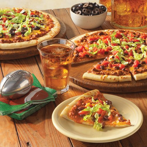 Wolf® Brand Chili Taco Pizza: Wolf Brand Chili mixed with tomato sauce becomes a quick pizza sauce.  Top with Cheddar cheese, black beans, tomatoes and lettuce for a taco twist