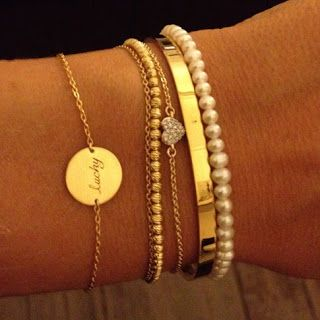 Gold bracelet stack. For reference, I'm terrible at mixing different styles together.