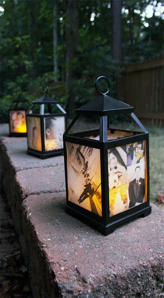 These custom photo lantern are beautiful as wedding centerpieces. They can actually do triple duty...hang them on hooks as aisle decorations at the ceremony; use as centerpiece or set them on a walkway to decorate the reception; and later use them to decorate your home. There's an LED candle inside. Scroll to number 24 on the page.