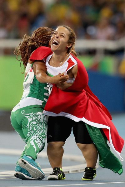 Lauritta Onye of Nigeria and Rima Abdelli of Tunisia  celebrate after the women's shot put F40 final at Olympic Stadium during day 4 of the Rio 2016 Paralympic Games on September 10, 2016 in Rio de Janeiro, Brazil.
