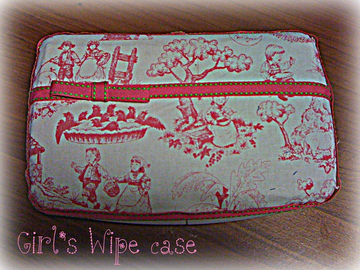 Wet wipe case decorated for a little girl, using hot glue, 1/4 yard fabric and some ribbon.