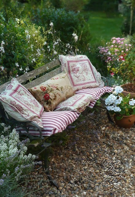 Love the pillows and the garden bench
