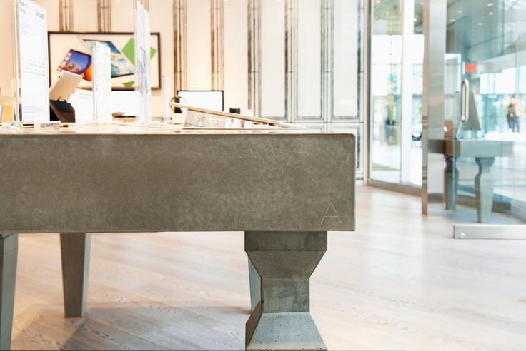 Detail shot of a concrete table. Concrete displays can add a modern and industrial look to commercial retail settings, institutions, and events. #concrete #table #interior #design #modern #tabletop