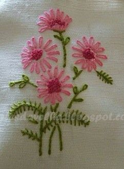 Embroidery pink flowers and green leaves.