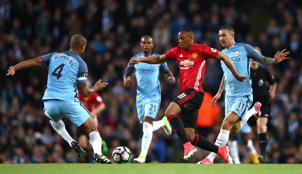 Anthony Martial of Manchester United takes on Vincent Kompany of Manchester City during the Premier League match between Manchester City and...