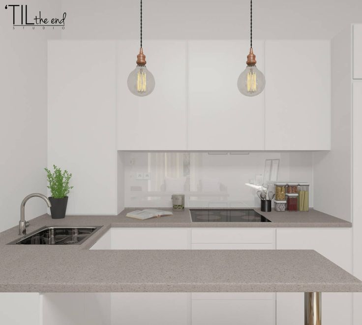 Cool, modern U shape kitchen with light grey benches and cool, on trend hanging edison style lamps. By 'TIL the end studio