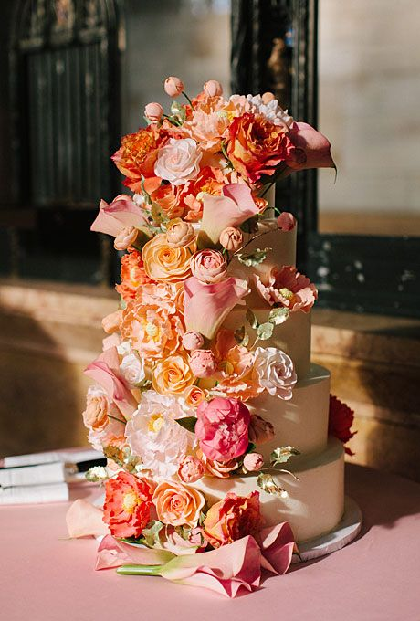 Pink, peach and orange abundance of flowers. The cake tiers alternated orange blossom with ginger butter cream, and dark chocolate with mocha butter cream. YUM!