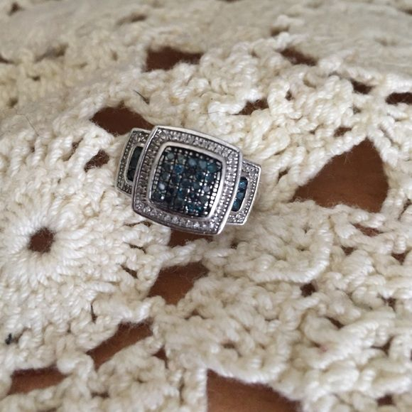 Sterling and blue diamond ring PRICE FIRM This is a sterling and blue diamond ring. I bought it at JTV and I need the money it's gorgeous and it has .33 carats worth of blue diamonds. Size 5. This is a eye catcher. NO TRADES. PRICE FIRM JTV Jewelry Rings