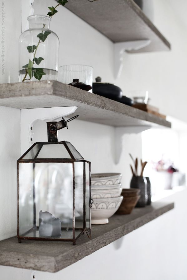 Love the grey stone and white shelves -Helt Enkelt