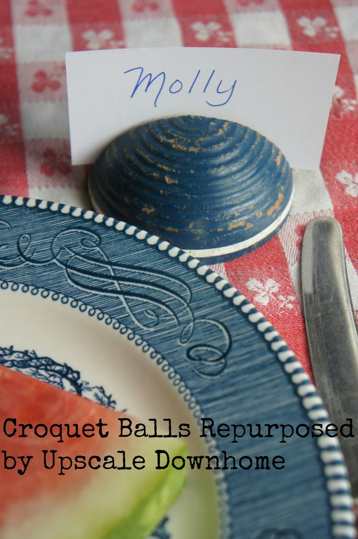 Fun ideas when you cut a croquet ball in half: picture holders, menu holders, place card holders....perfect for summer parties #upsaledownhome