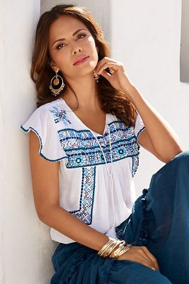 Our gauzy woven blouse is styled with a tassel tie front and intricate embroidery on the front, the short sleeves and back shoulder line.&#8226 Cotton.&#8226 Imported.&#8226 H