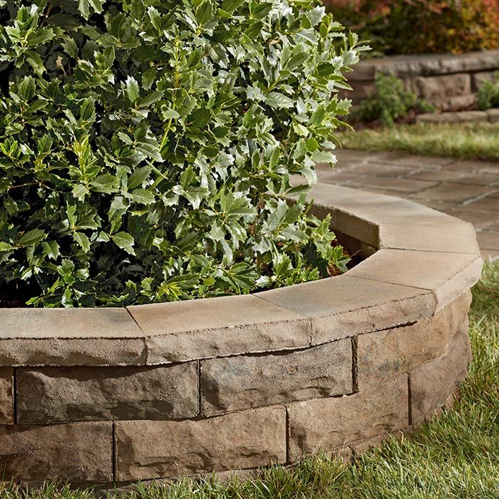 Patio blocks and pavers let you add function and design to for Block wall landscape design