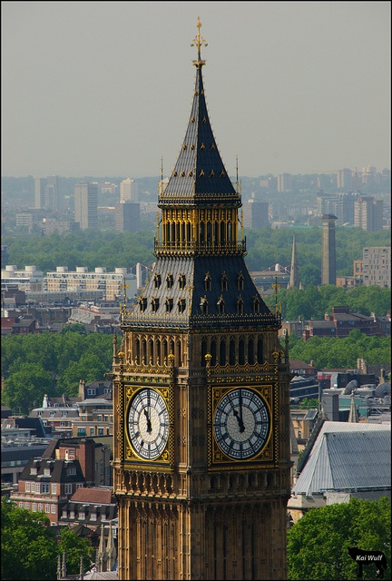 Big Ben Strikes 11  London's famous Clock Tower, commonly named Big Ben after the large bell that resides inside, strikes 11 AM. This viewpoint was captured from inside the capsule on the London Eye