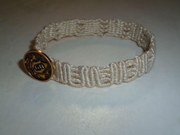 """M"" shaped bracelet with golden button"