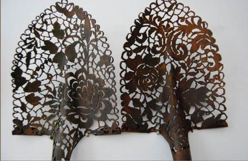 Cal Lane uses her welding torch to cut doilies and baroque patterns into mundane objects such as wheel barrows, I-beams, dumpsters and shovels. These objects, once relied upon for their durability, are transformed via oxyacetylene torch into delicate and decorative skeletons.    How creative!    http://www.callane.com/