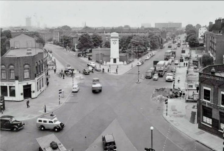 """1961 A photo taken from the top of""""The Swan Pub"""" in Stockwell showing Clapham Road, South Lambeth Road and Stockwell Road, bottom left is Douglas Young Estate Agents and centre to the left, just out of shot is Binfield Road. Just behind Douglas Young is """"The Tatler"""" Cinema, known by our parents as """"The bug hutch"""" during the war and used in later years as a snooker hall  and an Adult Movie Venue."""