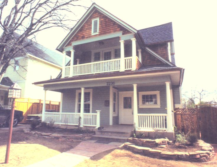A beautiful two story porch with columns and balustrade for 2 story porch columns