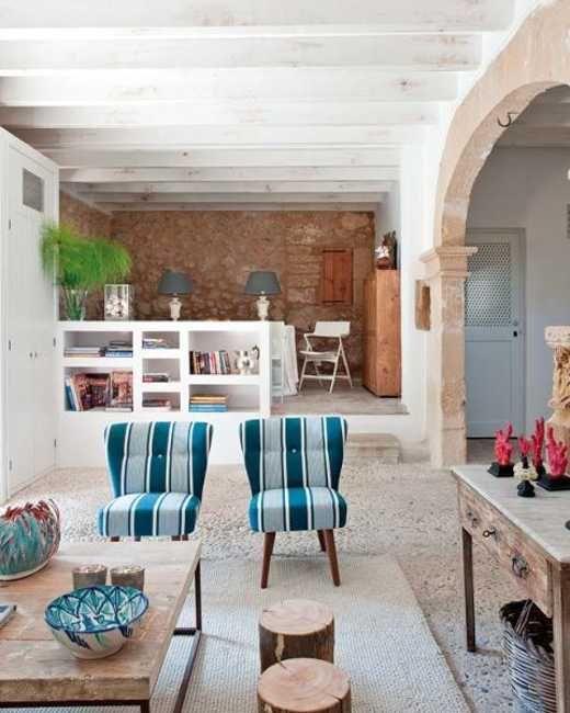 retro modern furnishings in rustic Tuscan interior