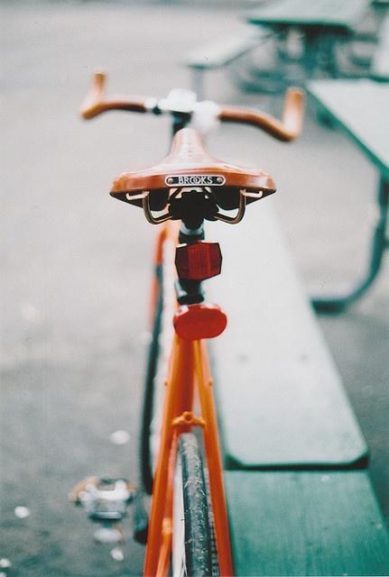 orange bicycle + brooks saddle