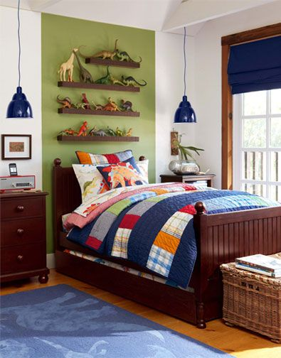"Love the one bold vertical stripe in a bright color instead of painting all the walls, the shelves above the bed are perfect for their ""collections"""
