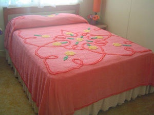vintage pink chenille bedspread - my own is turquoise and wonderfully soft. Chenille is underrated.