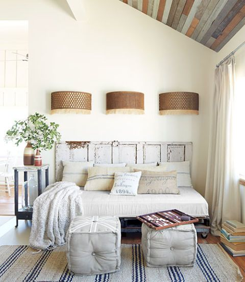 Modern Farmhouse style. The owner of this Texas home fashioned the frame of the daybed using a $25 flea-market door and pallets.