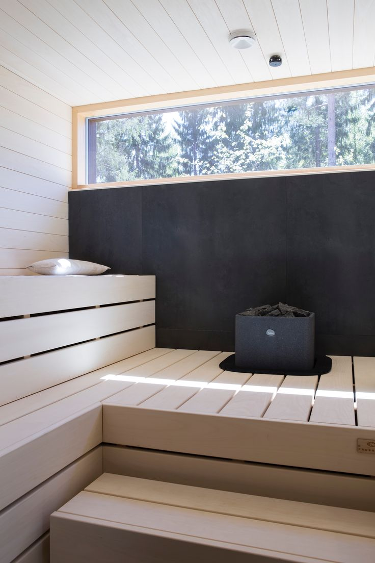 Light wood sauna interior with dark accents (and dark exterior)