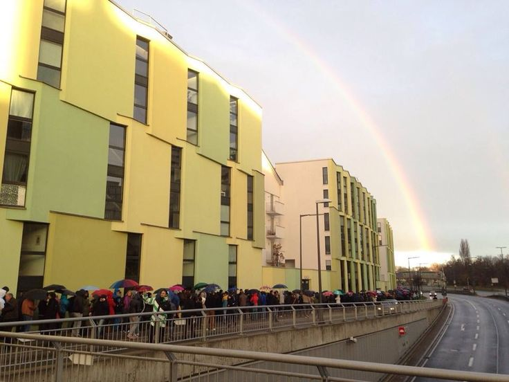 Germany. Munchen. 16 November 2014. 7:40 am. Romanians siting in a row to vote for their next President. The rainbow suggests a divine sign, believed to show the people who would be the best choice of President for all Romanians. (Foto: Facebook/ Oana Veronica Amarie)