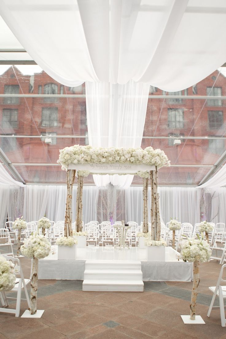 Columns ivory fabric uplighting wedding ceremony downtown double tree - Ceremony Seating Was Set In The Round With Three Aisles Outlined By Aspen Tree Trunks